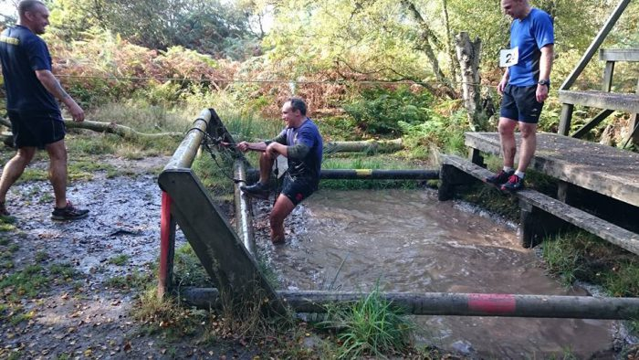 This obstacle course race is very wet, and muddy!
